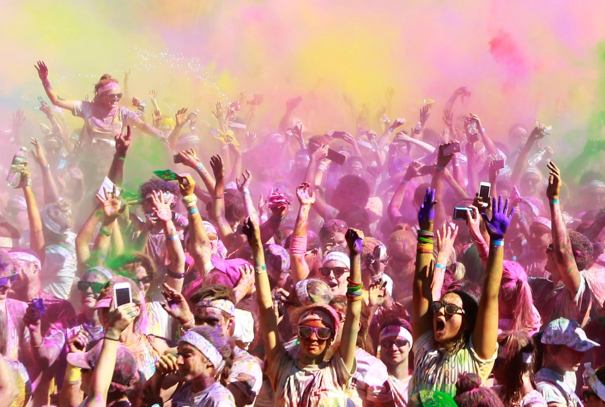 Runners cheer after they finish the Color Run at Sydney Olympic Park