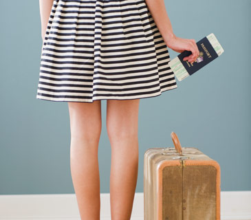 girl-with-passport-and-suitcase